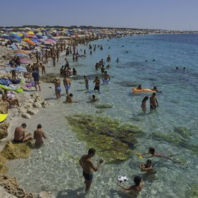 Crowded beach is Arutas, Sardinia, during Summer Time