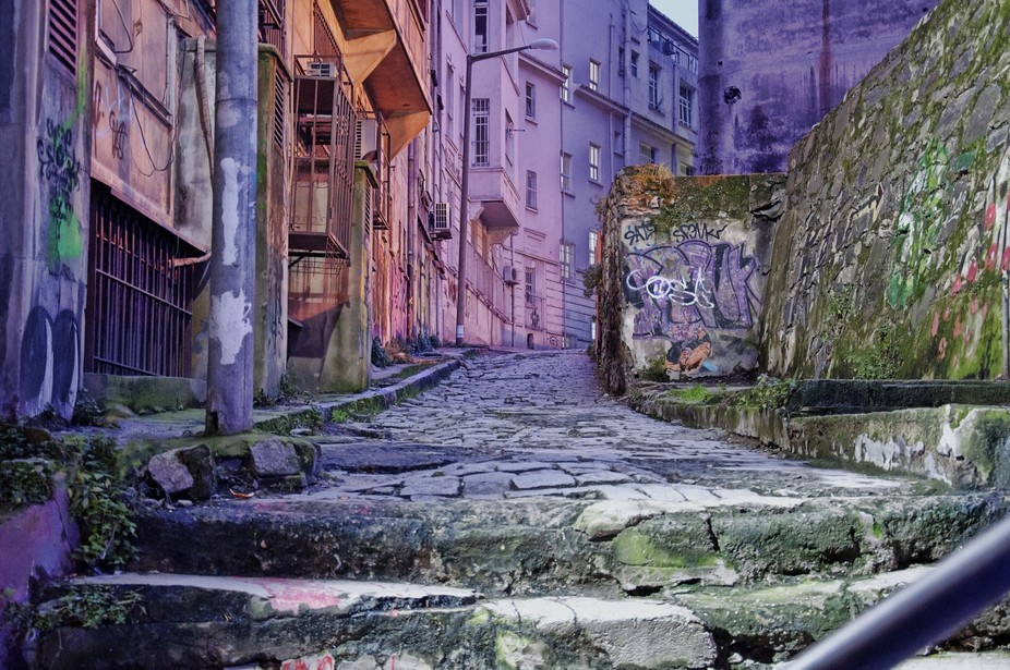 A cobblestone path in a back alley in Istanbul, Turkey.  It was taken in the evening and the ligh...