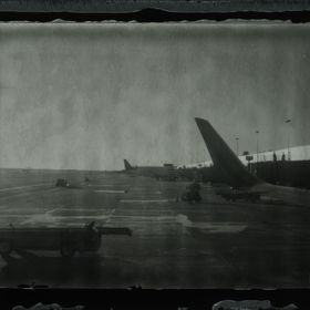 An inverted scan of shot of fp100b film through a Polaroid 100.  The organized chaos of an airport works well with the mixture of detail and impe...