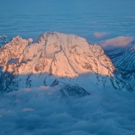 Mt. Moran at sunrise from above the clouds.