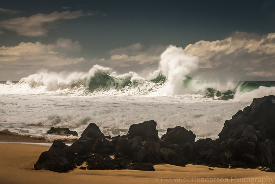 Waves break with splendor at Kalalau Beach on the Island of Kauai in Hawaii.