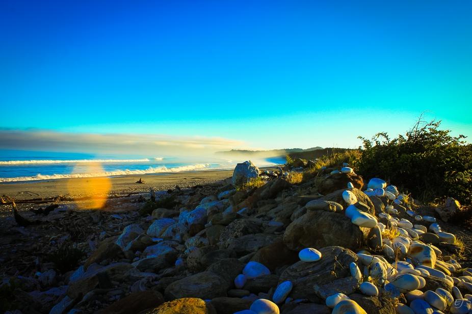 Sunrise shadow cast upon Bruce Bay on New Zealand\'s West Coast.