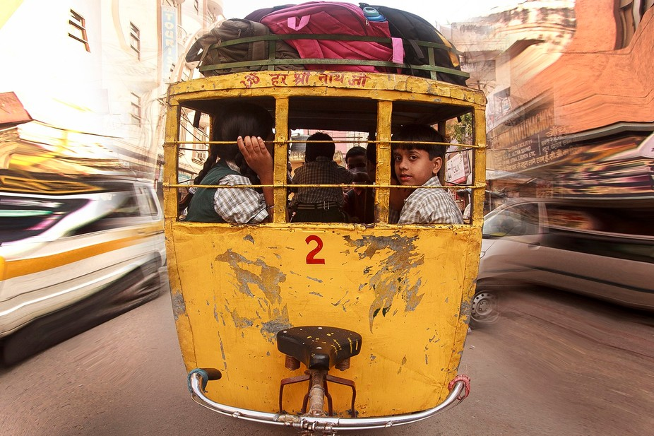 Children from the Indian city of Agra go to school with typical city transport.That is, in the da...