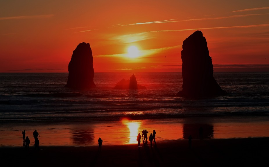 Groups of friends on the beach enjoying the sunset. (Cannon Beach, Or.)