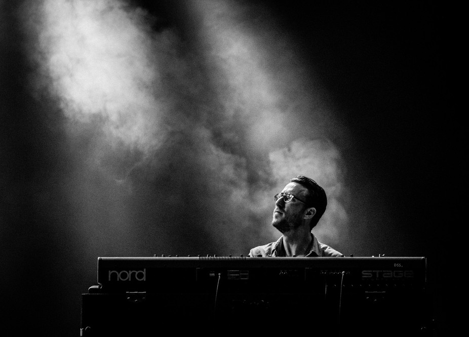 A keyboard player is playing with full concentration