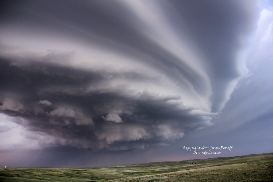 A dramatic arcus cloud with anticyclonic and cyclonic mesocyclones on a tornado warned storm near...
