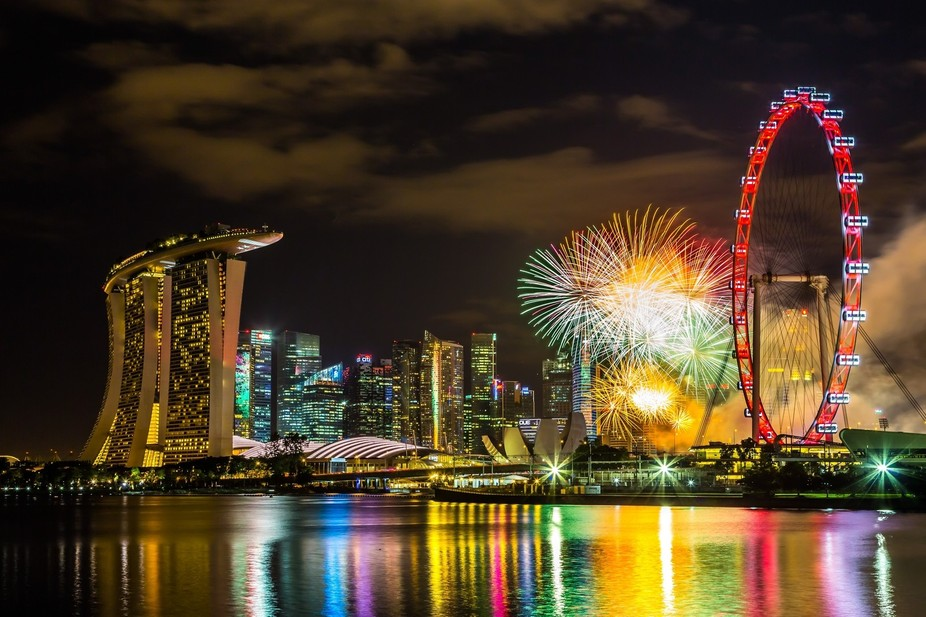 A firework display at Marina Bay Singapore showing the iconic Marina Bay Sands, Singapore Art and...
