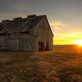 A barn at sunrise in Kentucky along the Ohio River.