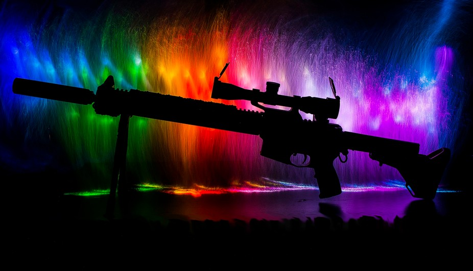 A silhouetted AR-15