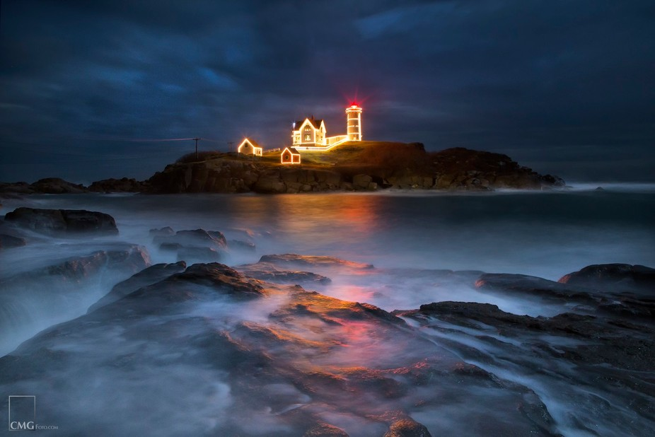 Nubble Lighthouse in York, Maine decorated for the holidays.