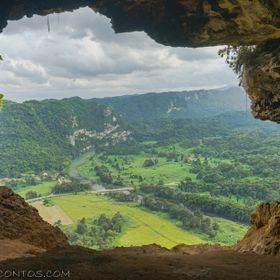 Cueva Ventana aka Window Cave in Arecibo, Puerto Rico is a small limestone cave system with a one hell of a grand finale! After a short, dark wal...