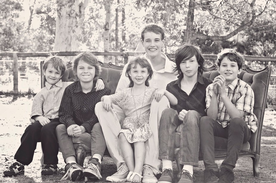 A photo of all my 6 kids , all together. :)