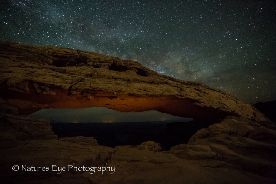 Milky way resting atop Mesa arch in Canyon lands