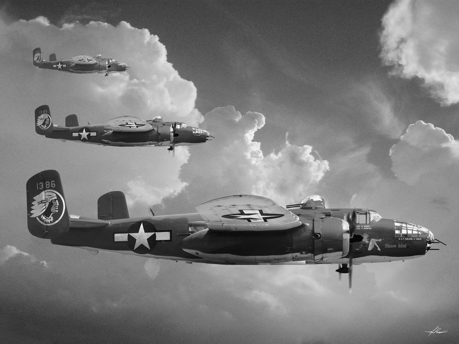 This is a composite picture built using a cloud background and an image from an airshow of a B-25...