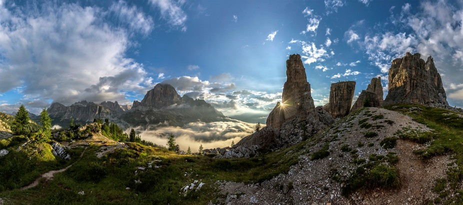 The five towers perched on their pedestal above the Falzarego Pass in the Italian Dolomites are a...