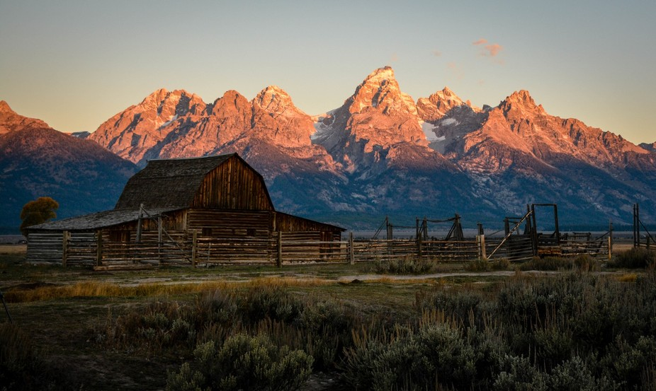 On a crisp, early October morning, the sun kisses the peaks of the Tetons as it silently rises ab...