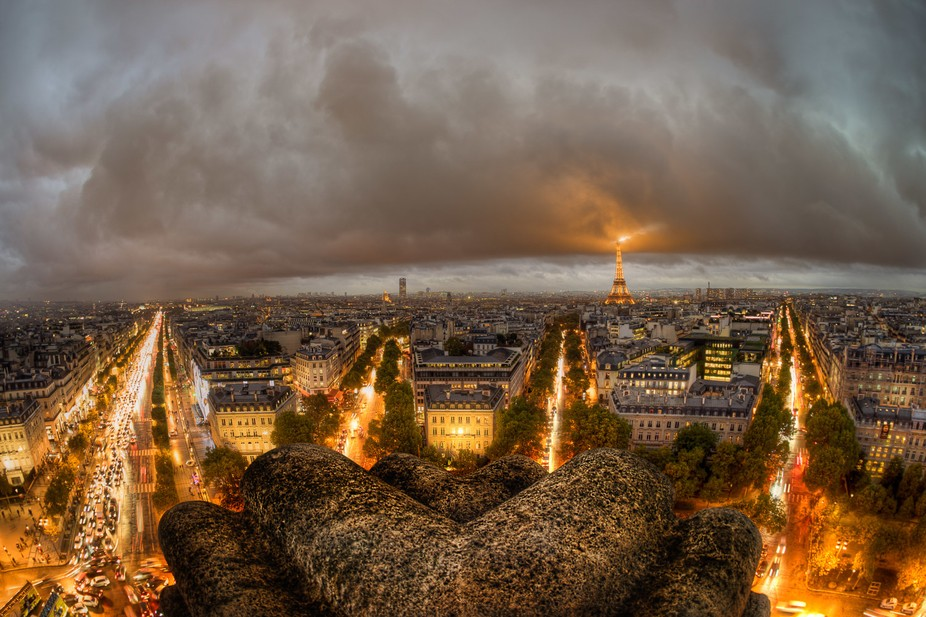 A grand view of Paris seen from the top of the Arch of Triumph. The weather was not very good for...