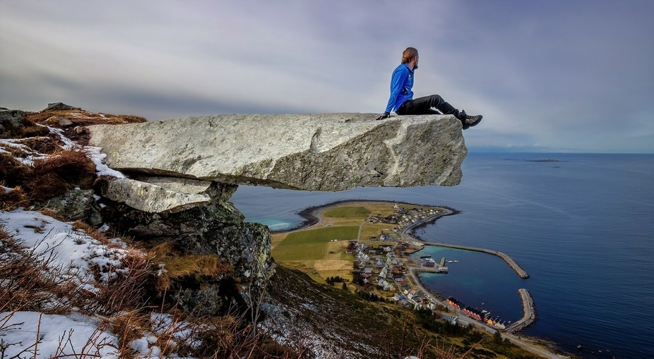 sitting at the edge of the rock out off the cliff, and for some people they are very scared of go...