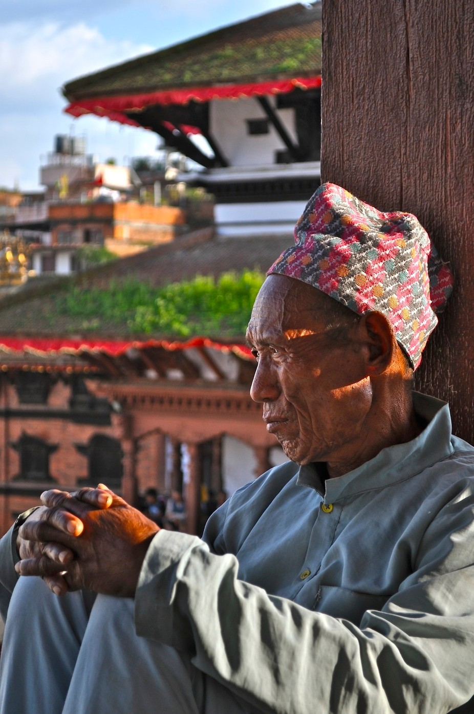 Amongst the crowds and the noise, this old man sat and watched the world go by.
