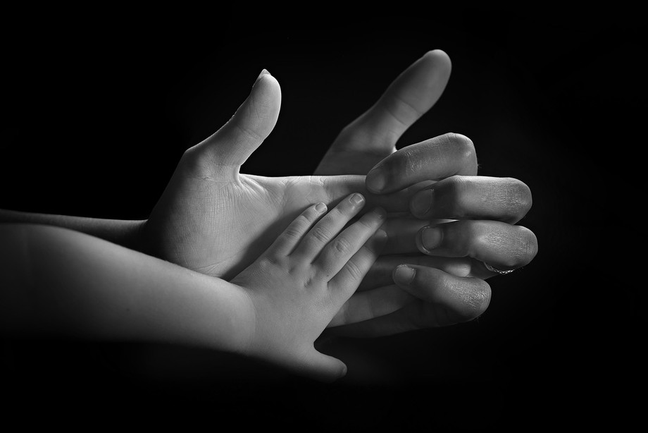 Hands from a series of family photos, with the hands interacting gave it more of a sense of invol...