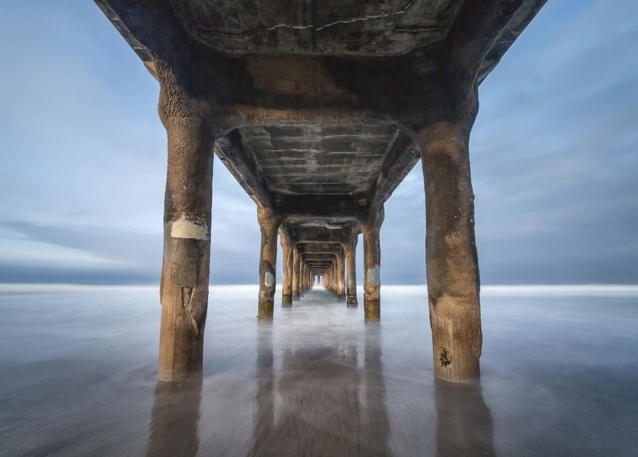 An early morning shot under the pier at Manhattan Beach, CA