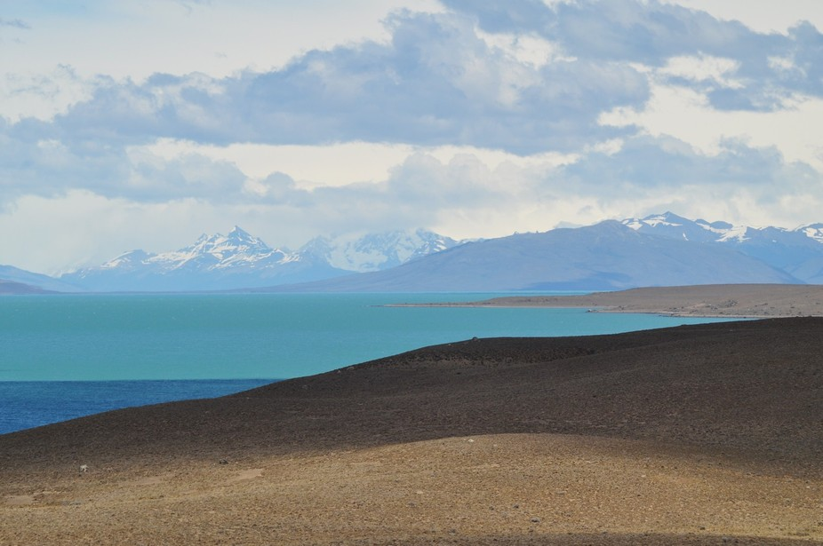 The drive across the desert from El Chalten to Calafate in Argentinian Patagonia is a mouthwatering series of contrasts, from the ochre coloured desert, across the turquoise glacial lakes to the snow capped Andes.
