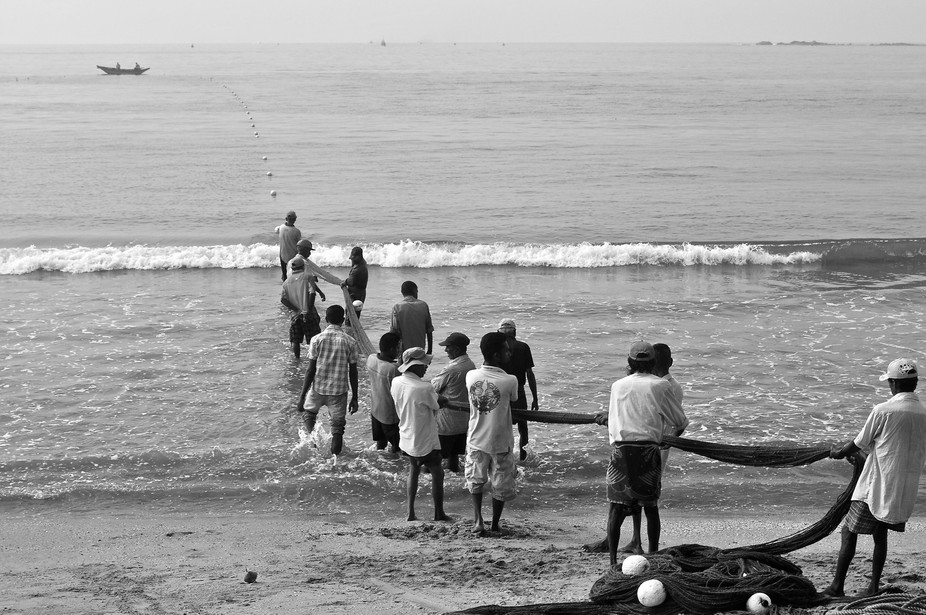 The village joins in the task of pulling the net in after a night's fishing