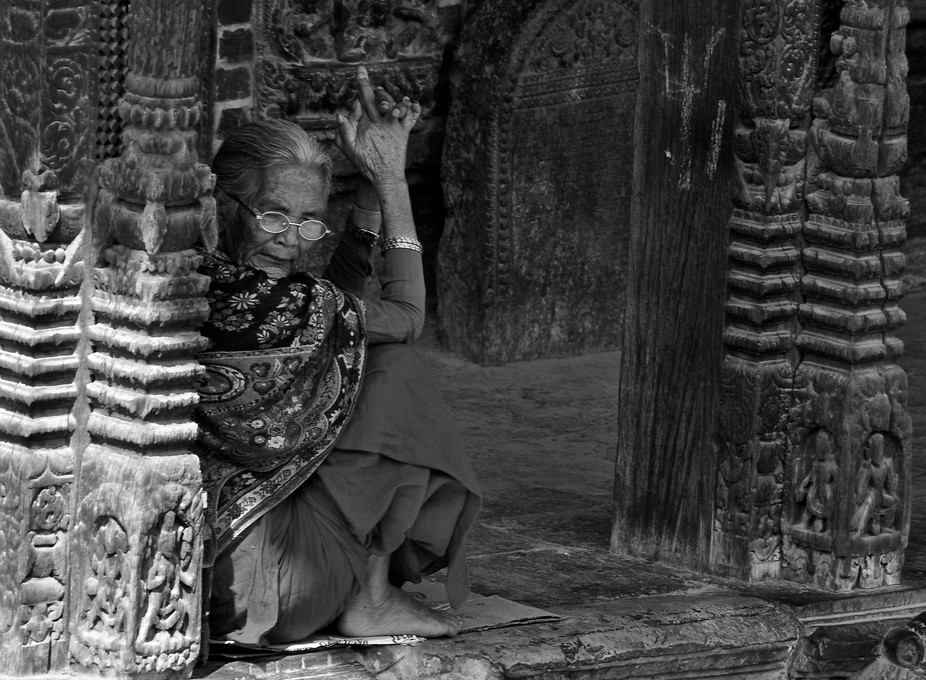 In the old city of Bhaktapur, near Kathmandu, locals relax in the shade of the temples.