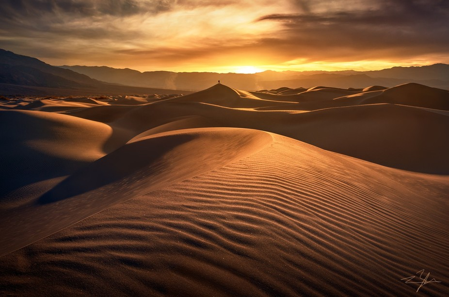 The Mesquite Dunes of Death Valley NP at sunset. Endless sand formations carved by the wind. Gian...