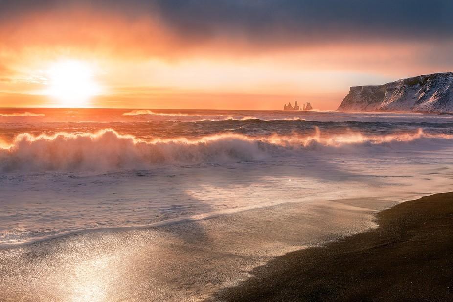 A beautiful sunset on a vulcanic beach in Iceland