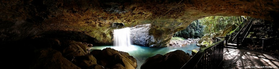 The magnificent Natural Bridge waterfall in full flow. Found in the Springbrook National Park in ...