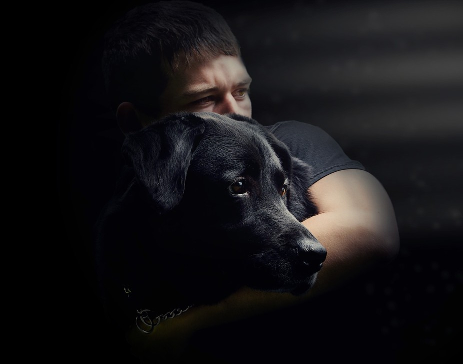A portrait of my son with his dog.