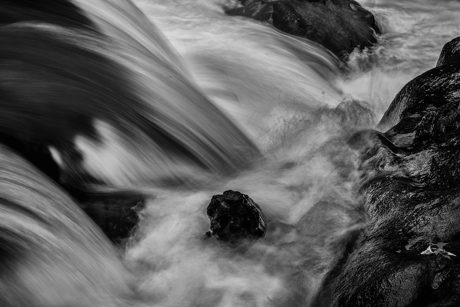As the water streams over the rocks the textures and tones emerge