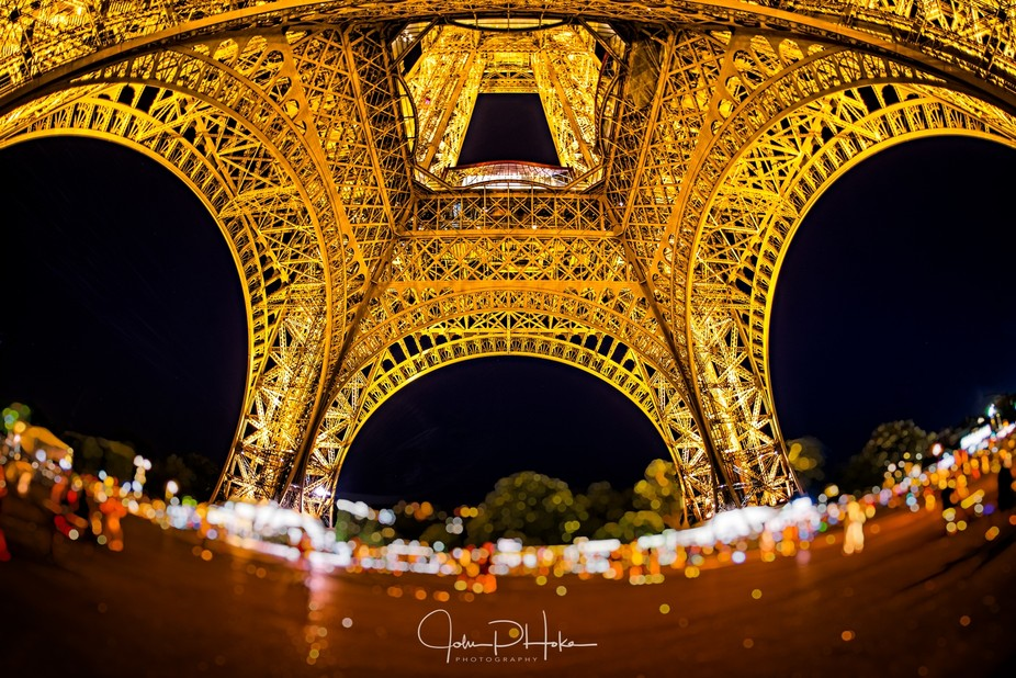 Night shot below the Eiffel Tower with a Sigma 15mm fisheyey lens.
