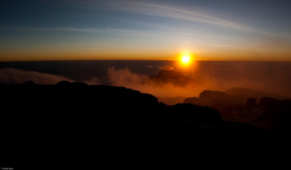 14th February 2010 - Sunrise at around 6.45am as seen from Uhuru Peak - Mount Kilimanjaro at an a...