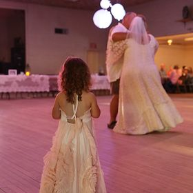 Shot during the reception of a recent wedding, I caught this sweet little one watching as her mom and grandpa danced.
