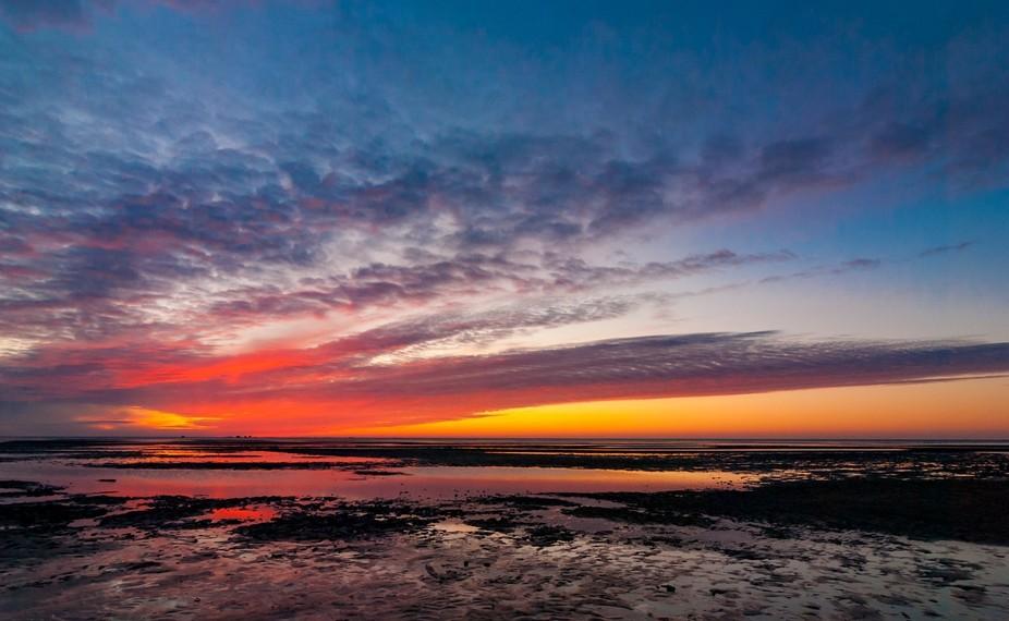 http://www.nicofroehberg.com/landscapes/thefeelingofsunrise  Sunrise over the Wadden Sea of North...
