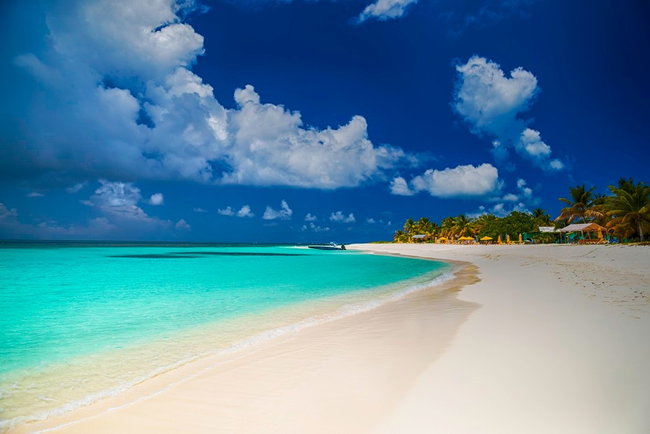 Such a beautiful beach with crystal clear water and soft sand.