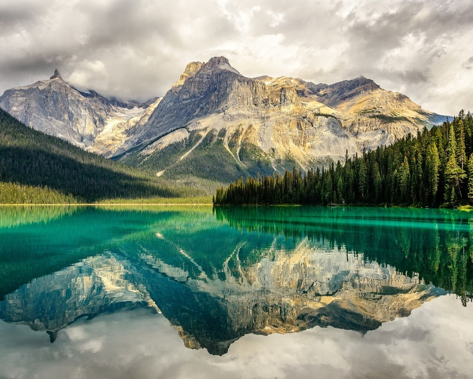 As we walked around Emerald Lake, the stormy weather paused, the wind calmed and the sun broke th...