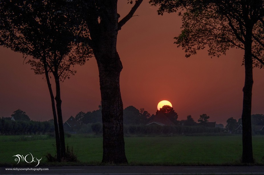 On an unusual hot summer evening the sun set and looked so big that I could not stop photographin...