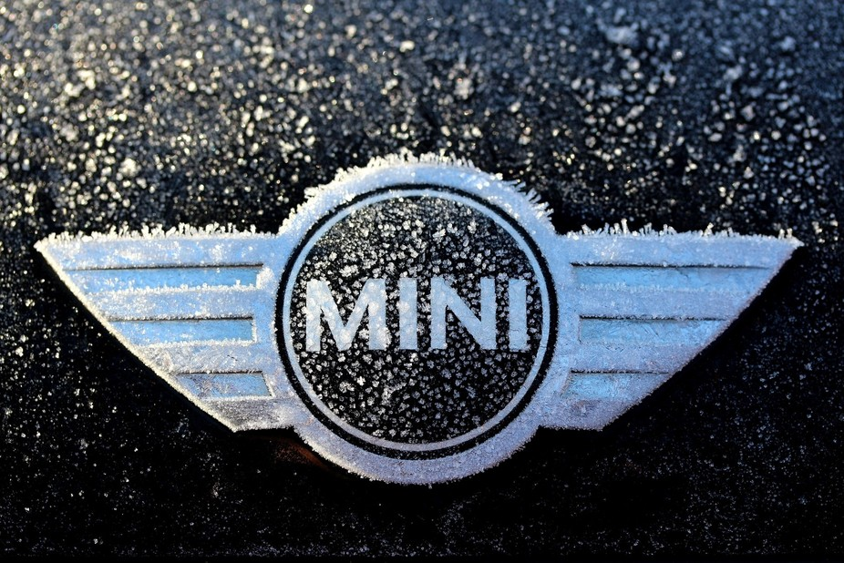 Mini badge side lit by sun on a frosty morning.