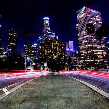Downtown Los Angeles, California from the 4th St. bridge, looking toward the Bonaventure Hotel and US Bank Tower.  Taken with tripod and time exposure.