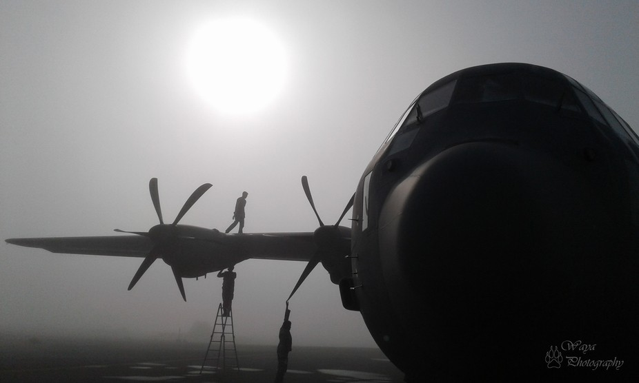 My engine ground run students doing their preflight inspection in the morning fog.