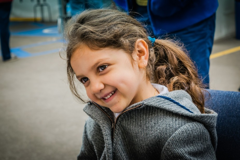 Candid shot of young girl at an art festival in Rosarito Beach, Baja California, Mexico