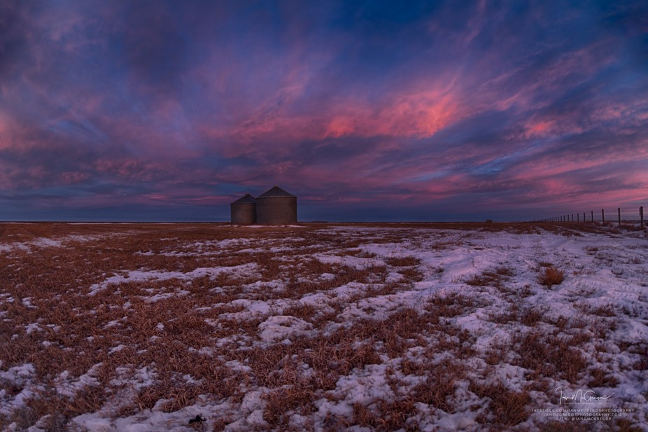 Twilight moments over a farm field on the Canadian prairie.
