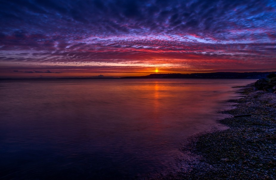 Sunrises over Port Townsend Peninsula on the Strait of Juan de Fuca in late April. Mount Baker is...