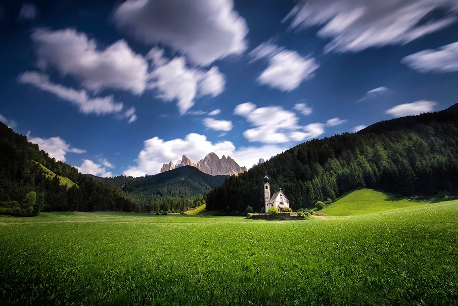 Small church Santa Madalenna in Val di Funes under the peaks of Dolomites