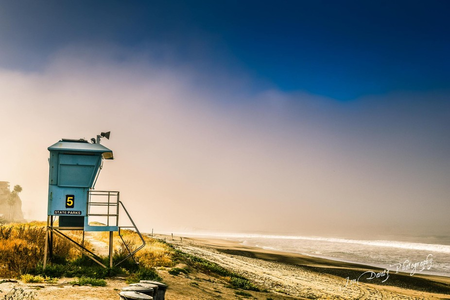 A lifeguard station with fog rolling in