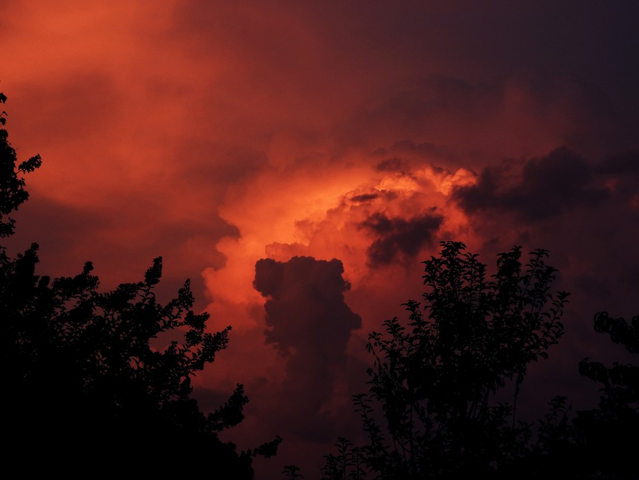 Storm clouds building at sunset