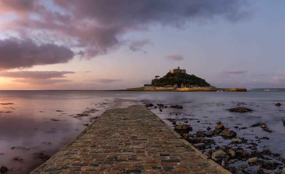 The beautiful morning light hitting St. Michaels Mount as the sun peaks over the horizon. This pa...